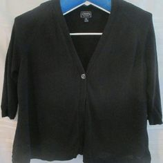 """Chaps Classic Black One Button Sweater Cute black sweater with a one button closure. In good condition with only gentle wear. With garment laying flat measures as follows: 26"""" chest, 22"""" shoulders, 15"""" arm pit to bottom hem, 25"""" shoulder to bottom hem, 32"""" waist, 16"""" sleeve. Chaps Sweaters Cardigans"""