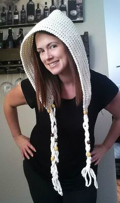 You can do so many things with a basic crochet hood! You can give it braids, buttons, beads, add ears, horns, eyes, pom poms, and so much more. I've been making a few hoods lately, and this is the pa