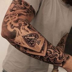 Badass Full Sleeve Arm Tattoo Designs - Best Full Arm Sleeve Tattoos For Men: Cool Sleeve Tattoo Designs and Ideas tattoo ideas for guys 101 Best Sleeve Tattoos For Men: Cool Designs + Ideas Guide) Half Sleeve Tattoos For Guys, Half Sleeve Tattoos Designs, Cool Tattoos For Guys, Best Sleeve Tattoos, Trendy Tattoos, Popular Tattoos, Tattoo Designs Men, Body Art Tattoos, Mens Tattoos
