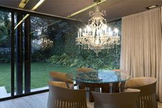 Renovated Mexican Residence by Paola Calzada Arquitectos dining area crystal chandelier