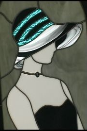 Woman profile black dress and black and turquoise striped hat
