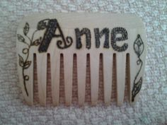 Wooden hair comb with pyrography pattern