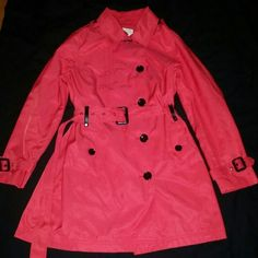 "Michael kors red belted trench coat  Mk petite So sexy! Michael kors trench coat. Rich red! Belted around waist, around wrists, and at collar. There's a small clear stain I tried to get a pic of it in the last pic, you can only see it in certain lighting but it is there. Measures:  length 33"", waist when buttoned across 19"", shoulder to shoulder 16"", inseam of arm 17"" button straps on shoulder. Pockets for your hands. Collared. Black buttons. Size is a petite large MICHAEL Michael Kors…"