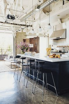 www.thisisglamorous.com   Floods of light and clean lines in this modern loft in Los Angeles which belongs to Joan McNamara of Joan's on Third, a cafe and gourmet food market she founded in the 1990's, the industrial chic loft is actually only a few blocks away from the cafe.