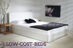 6ft Superking White Ottoman Frame - £649.95 - This superb white ottoman bed in may appear to look similar to other designs out there but is clearly made to a very high standard, it features from a deep padded headboard and foot board and side rails, high quality frame with deep internal storage area with heavy duty fabric finished bottom to keep the storage items away from the floor.