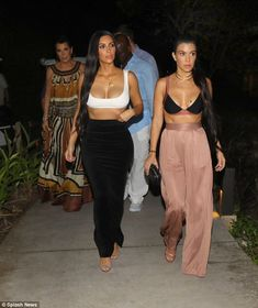 Girl power: Behind Kim and Kourtney was momager Kris and beau Corey