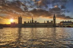 Westminster Palace & Portcullis House from the Thames Walk - sunset. By Andrew Thomas, Flickr, 2012.