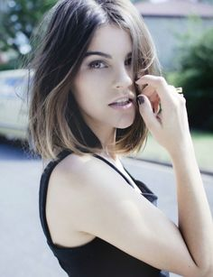Bob Style: Short, middle part, very little layering or texture.