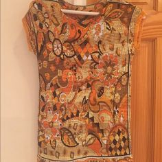 Vintage Boutique Styled Top Vintage Boutique multi-colored floral top with warm color-tones. Colors are orange, brown, yellow with some black accents. Size is Medium but it stretches to a large. It has been worn a few times but it is in excellent condition. Tops Blouses
