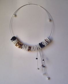 porcelain jewelry: necklace,  hand shaped translucent porcelain, fired to 1200°c, golden luster, metal wire