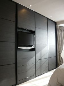 Wardrobes either side of chimney breast
