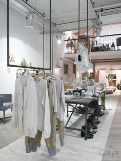 """flagship store   """"yaya""""   amstelveen, the netherlands. Center racks attached to the ceiling."""