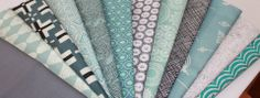 The fabrics included are Carolyn Friedlander Crosshatch in Black, Jenean Morrison Flower Child Carnation, Uno Sea plant grey, Free Spirit solids Rose, Oval Elements Silver Drops.