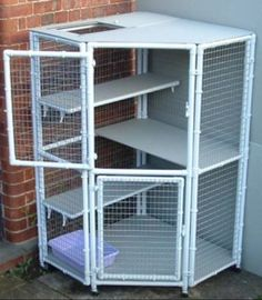A pet cage that fits into a corner. Can be used as an outdoor cat enclosure or indoor cage. Cage Chinchilla, Ferret Cage, Rat Cage, Rabbit Enclosure, Outdoor Cat Enclosure, Reptile Enclosure, Bunny Cages, Rabbit Cages, Cat Cages Indoor