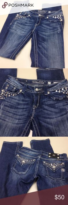 Authentic designer  jeanssale 1 HR Medium blue denim. Trimmed in  Silver tone studs. M- emblem on pockets . Silver & rhinestone studs on rear pockets. 32' inseam. Straight legs. Good condition & sexy fitted. 2%elastic Miss Me Pants Straight Leg