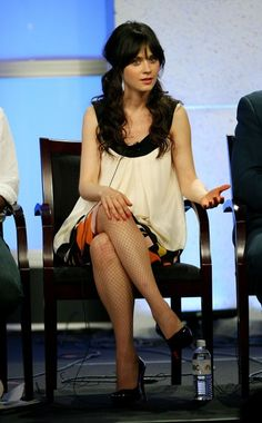 """BEVERLY HILLS, CA - JULY 17:  Actress Zooey Deschanel of """"Tin Man"""" speaks during the 2007 Summer Television Critics Association Press Tour for NBC held at the Beverly Hilton hotel on July 17, 2007 in Beverly Hills, California.  (Photo by Frederick M. Brown/Getty Images) *** Local Caption *** Zooey Deschanel"""