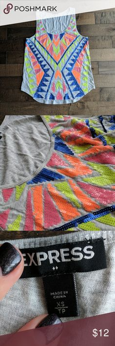 Sequin Express top Express tank top, Aztec/tribal print  Pair with new balance retro or modern sneakers. Found a perfect match see last photo :)  Size XS, but good for S as well.  Never washed or worn Excellent condition  Price is firm unless bundled Express Tops Tees - Short Sleeve