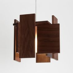 Wood panels arranged on different planes create a unique, geometric shape. http://www.ylighting.com/cerno-abeo-l-led-pendant-light.html #YinTheWild