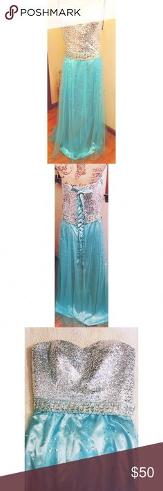 """Pastel Blue Prom/Pagent Gown size 22 This is a pretty pastel blue gown designed with silver sequence. I purchased it adjustable in all aspects so that fit was not an issue. It's strapless with an inside bra strap. It ties up the back so you can have extra room if needed and the waistband moves to your figure. my daughter had other ideas and never wore it so maybe someone will put it to good use. Bust 22"""" waist 21"""" and length from the waist down is 44"""" Dresses Prom"""