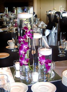 Trio Vase Centerpiece with Purple/Magenta Dendrobium Orchids with Floating Candles
