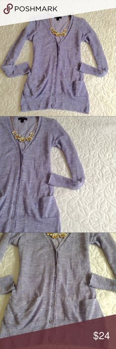 J.Crew Lavender Cardigan Model is wearing the same cardigan in a navy color. This one is a unique lavender color. Features two pockets. In good condition.. A classic cardigan in a superfine baby-rib cotton J. Crew Sweaters Cardigans