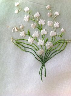 Lovely green all cotton ladies handkerchief in shades of green fading to an all most white center with lovely Lily of the Valley bouquet at the