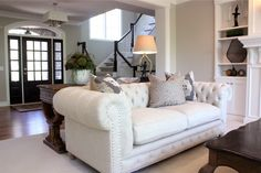 Neutral updated traditional sapce.  Love how it's decorated - especially the chesterfield sofa