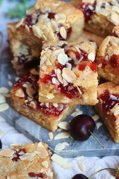 Thick and Gooey Bakewell Blondies with Ground Almonds, Raspberry Jam, and Flaked Almonds on top! Heaven in every Bakewell Bite. Tray Bake Recipes, Brownie Recipes, Baking Recipes, Cake Recipes, Dessert Recipes, Vegan Desserts, Scones, Bakewell Cake, Janes Patisserie