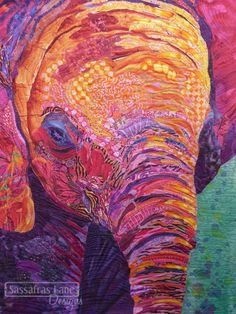 Elephant quilt, collage technique by Darlene Determan. Quilting: Thread Painting by Kristy Wolf.  Sassafras Lane Designs.