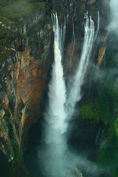 "Angel Falls (Kerepakupai Merú) ~ The world's highest free-falling waterfall at 979 meters ft.) in Canaima National Park, Venezuela. ~ by Ian Lambert ~ Mik's Pics ""Nature Scenes lll"" board Angel Falls Venezuela, Places To Travel, Places To See, Places Around The World, Around The Worlds, Beautiful World, Beautiful Places, Amazing Places, Amazing Photos"