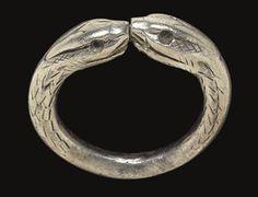 A ROMANO-BRITISH SILVER SNAKE RING                                                                                                                                                                       CIRCA 2ND CENTURY A.D.