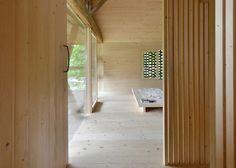 Slovenian studio OFIS Arhitekti has converted a run-down old cattle barn into an Alpine holiday cabin.