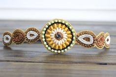 Vibrant and Festive Bohemian Beaded Head piece, In Hues of Yellow, Ivory, Gold and Green. Features a elastic back and felt lining to give you a non-slip grip. You are bound to get many complaints with this one of a kind head piece from my fashion creations. Delicately placed and assembled Seed an...