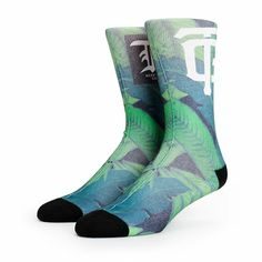 A soft blended construction provides great comfort with an all-over sublimated green floral print with Neff and TG logo graphics at the upper shin.