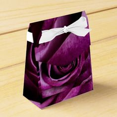 Rose Dark Plum Favor Box Intense coloured rose petals of a purple plum colour. A really stand out design for lovers of purple. The individual petals are easily seen.Gorgeous teamed with a crisp white.