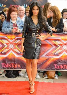 Sizzling Scherzy: Nicole Scherzinger stood out from her fellow judges as The X Factor auditions arrived in London on Wednesday