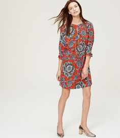 """In a regal paisley floral, this henley shirtdress is the kind of versatile staple that every closet needs. Collarless. Long sleeves with button cuffs. Shirred beneath shoulders. Henley button placket. Removable waist tie. Back yoke with shirring beneath. 19 1/2"""" from natural waist."""