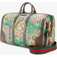 Gucci Gucci Bengal GG Supreme duffle bag ($1,570) ❤ liked on Polyvore featuring men's fashion, men's bags, mens leather duffel bag, men's duffel bags, mens leather bags, gucci mens bag and mens duffle bags