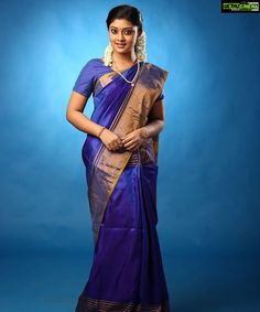 In a dark blue color kanchipuram saree / pattu saree, short sleeve blouse design and long chain Beautiful Girl In India, Most Beautiful Indian Actress, Beautiful Saree, Child Actresses, Indian Actresses, Reception Sarees, Indian Wedding Makeup, Saree Hairstyles, Costumes Around The World