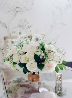 White %26 Blush Rose Arrangement on Table    Photography: Jose Villa Photography   Read More:  http://www.insideweddings.com/weddings/glamorous-sophisticated-garden-themed-ballroom-wedding-in-chicago/905/