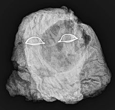 X-ray photograph of E17911 – We can see a lot of termite tunnels and the big hole inside the head, on the right-hand side, and the shining eyes. http://www.penn.museum
