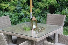 copper lantern and foliage on outdoor furniture
