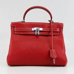 Every Girl should have a red handbag!  Hermes red handbag