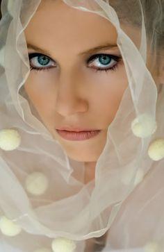 White veil and pretty eyes.