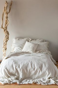 Linen bedding-lovely neutral textures  This with those huge papaer flowers would be AMAZING