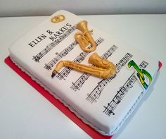 Music wedding cake - Weddingcake for a couple of a marching band with their instruments and the club logo! The musicnotes are handpainted! Cake is filled with chocolatecake and chocolate ganache.