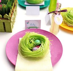 Place settings are topped with edible grass nests, with chocolate malted eggs.  You can use the very small clear plastic plates from the Dollar Tree to hold the nest neatly as you move it about.
