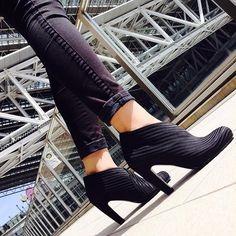 BEST SELLER The United Nude Fold is all about motion.The Fold's entire upper is made from a single strip of United Nude's signature elastics moving fluently around the foot, like a scarf wrapped around a slender neck. A slip-on ankle bootie based on a comfortable, slightly wider heel with a rounded toe. Textured rubber outsole.