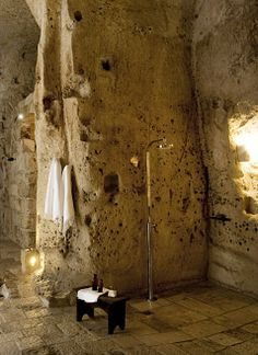 UNESCO world heritage listed. The hotel is spread over a number of Sassi or caves, and simply furnished. Modern black bathtub and shower.