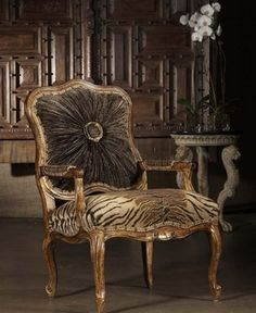Tiger striped seat and a gathered back. Classy and funky at the same time! High style furniture